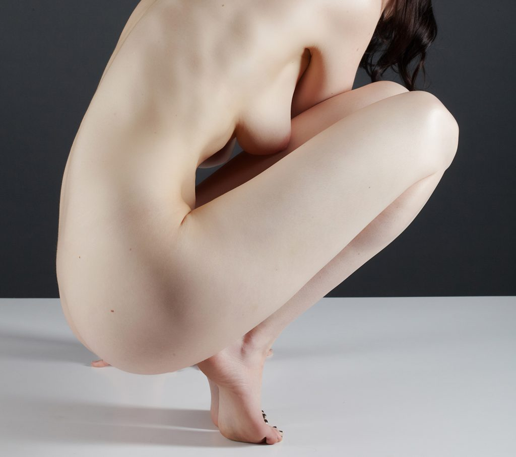 Artful nude in studio by San Francisco based photographer, Peter Samuels